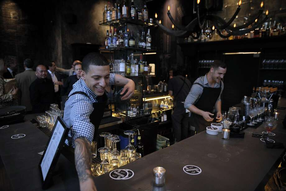 Bartenders work the main bar at the new Black Cat. Photo: Carlos Avila Gonzalez, The Chronicle