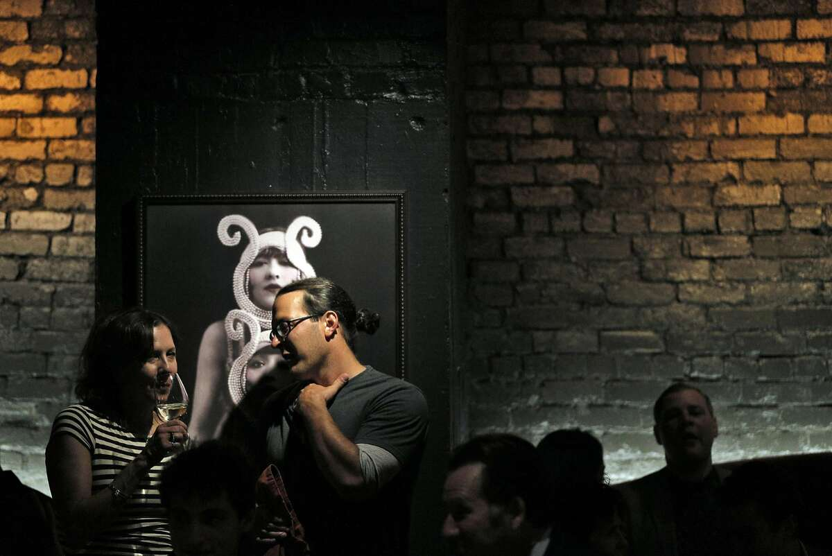 Guests enjoy drinks at the jazz performance in the downstairs bar area at the new Black Cat Restaurant and Bar in San Francisco, Calif., on Wednesday, July 27, 2016. Black Cat opens Thursday, July 28, and features a jazz revue in the lower floor.