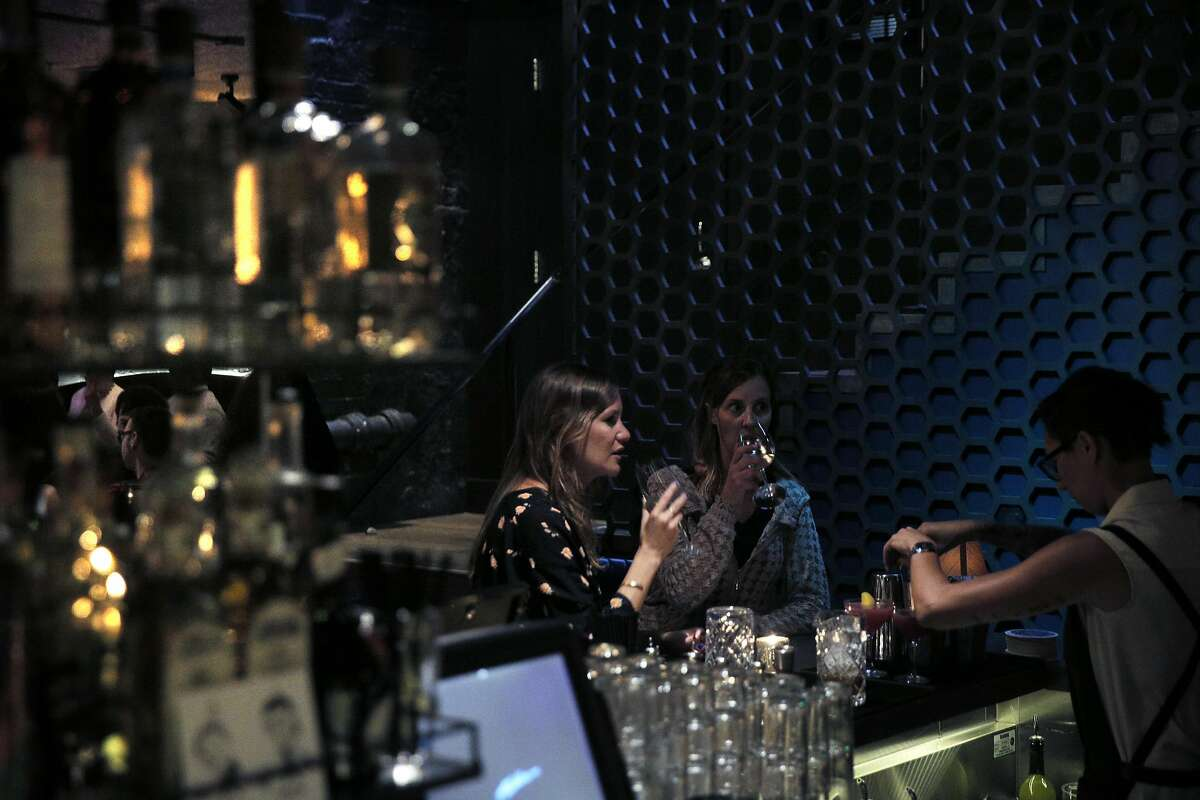 Two guests enjoy drinks at the downstairs bar at the new Black Cat Restaurant and Bar in San Francisco, Calif., on Wednesday, July 27, 2016. Black Cat opens Thursday, July 28, and features a jazz revue in the lower floor.