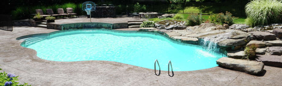 An inground pool with water features made by Nejame & Sons pool company in Danbury. Photo: Contributed Photo / The News-Times Contributed