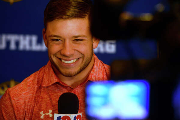 Lamar University running back Kade Harrington does an interview with a television station during the Southland Conference media day in Lake Charles on Wednesday.  Photo taken Wednesday 7/27/16 Ryan Pelham/The Enterprise