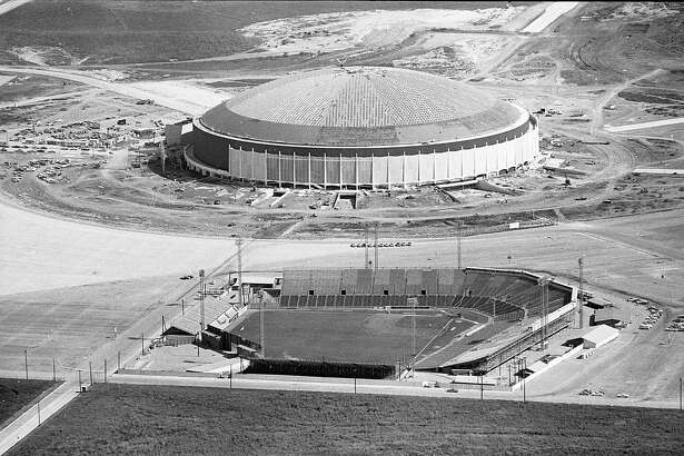 Colt Stadium in foreground with Astrodome construction in background, early 1960s.