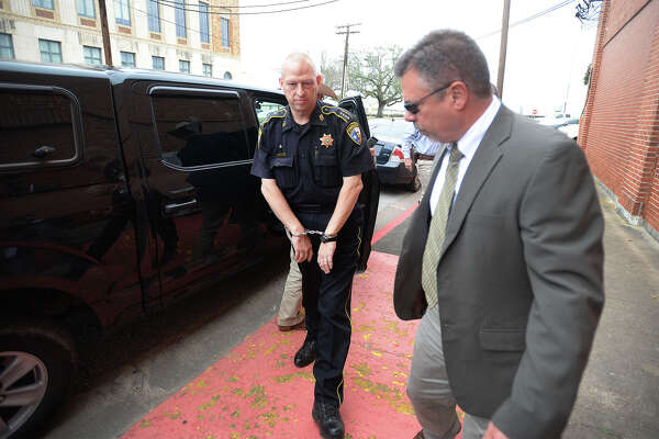 John Joslin a Liberty County constable is escorted to the Jefferson County Courthouse Annex Monday in connection with an officer impersonation case.  Photo taken Monday, January 25, 2016 Guiseppe Barranco/The Enterprise