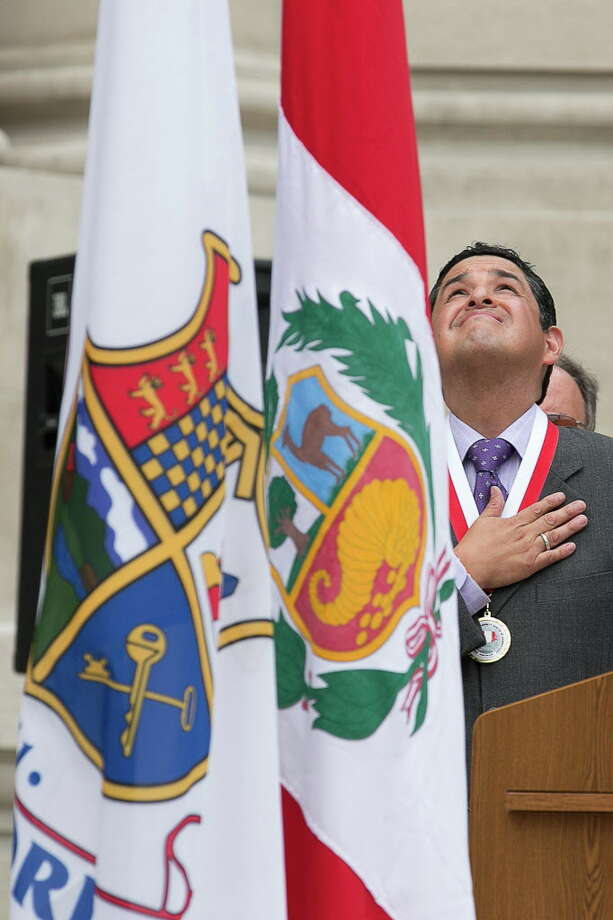 Mike Ross Connecticut Post freelance -Peruvian American Community Center of Connecticut president Alex J. Martinez salutes during the raising of the Peruvian Flag during Sunday's afternoon South American countryâÄôs independence day celebration day event at Old Town Hall. Photo: Mike Ross / Mike Ross / @www.mikerossphoto.com