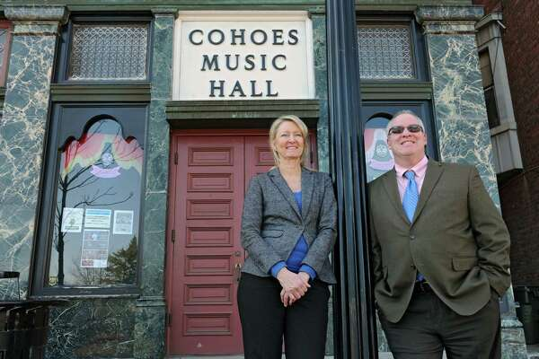 Palace Theatre manager Holly Brown and Cohoes Mayor Shawn Morse stand outside the Cohoes Music Hall on Tuesday, March 22, 2016 in Cohoes, N.Y. Palace Theatre is taking over management of Cohoes Music Hall. (Lori Van Buren / Times Union) ORG XMIT: MER2016032215591965