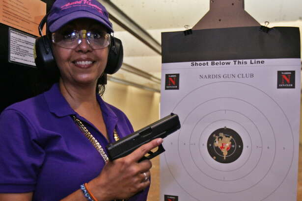 Displaying a ragged bull's-eye, Michelle Crippen, founder of the San Antonio Chapter of The Well Armed Woman, says she couldn't hit the broad side of a barn when she first started shooting.