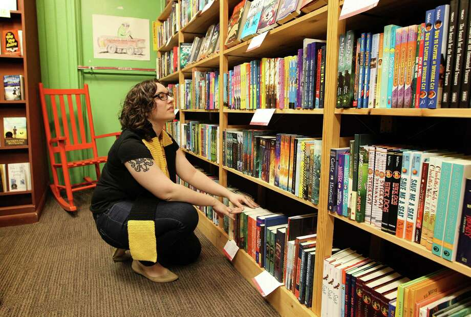 """Liz Wright, the children's specialist at Brazos Bookstore, is 25 and grew up obsessed with Harry Potter. She's organizing the store's midnight party on Saturday to celebrate the release of """"Harry Potter and the Cursed Child."""" Photo: Steve Gonzales / © 2016 Houston Chronicle"""