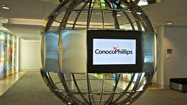 ConocoPhillips reported a second-quarter loss of $1.1 billion, compared with a shortfall of $179 million, a year earlier.