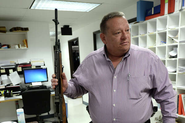 Vidor Police Chief Dave Shows holds one of the M14 assault rifles given to his department by the U.S. Department of Defense. Two M16s can be seen on the table. Photo taken Thursday, January 22, 2015 Guiseppe Barranco/The Enterprise
