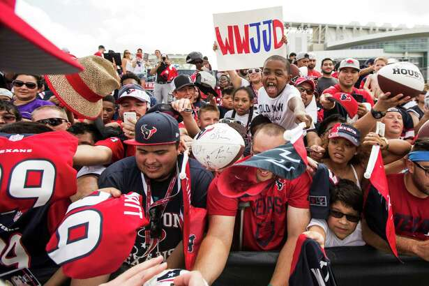 Houston Texans fans reach out for autographs during Texans training camp at the Methodist Training Center Wednesday, Aug. 19, 2015, in Houston.  ( Brett Coomer / Houston Chronicle )