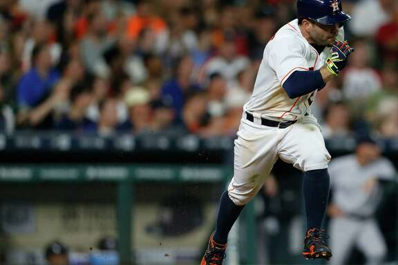 Houston Astros second baseman Jose Altuve (27) runs up the line as he singled during the fifth inning of an MLB game at Minute Maid Park, Wednesday, July 27, 2016, in Houston. ( Karen Warren  / Houston Chronicle )