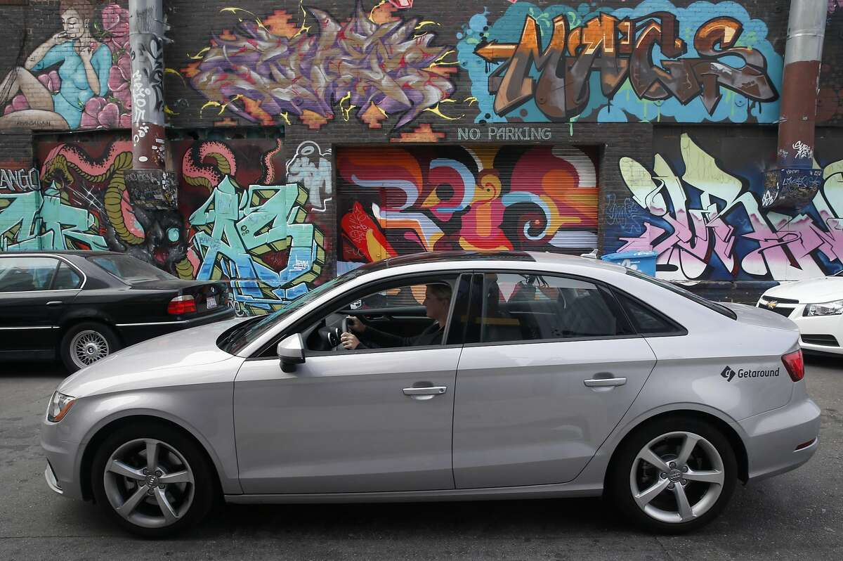Emily Benjamin and Jamie Talbot take a ride in their Audi A3 in San Francisco, Calif. on Thursday, July 28, 2016. They make the car available to rent through the Getaround car sharing service which defrays their operating costs.