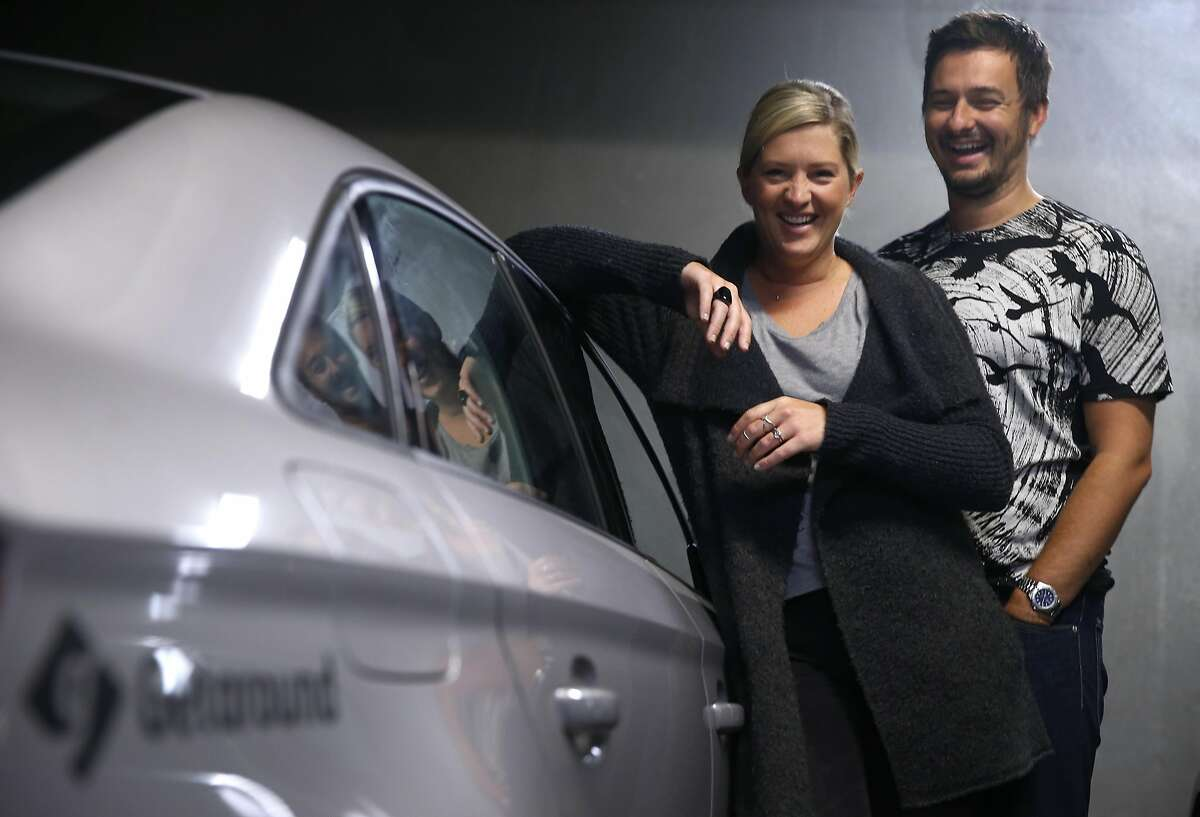 Emily Benjamin and Jamie Talbot stand by their Audi A3 after taking a drive in San Francisco, Calif. on Thursday, July 28, 2016. They make the car available to rent through the Getaround car sharing service which defrays their operating costs.