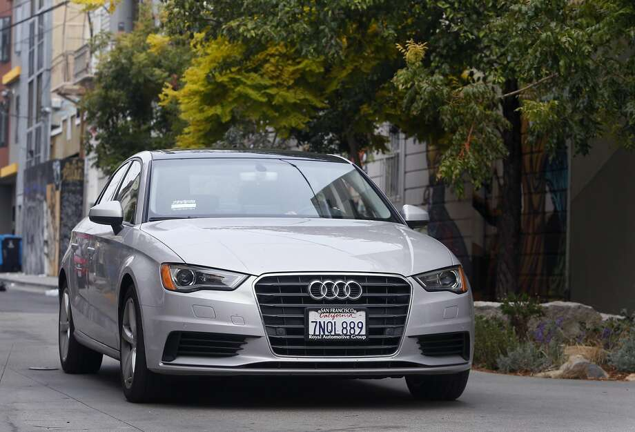 Emily Benjamin and Jamie Talbot ride in their Audi A3 in San Francisco, Calif. on Thursday, July 28, 2016. They make the car available to rent through the Getaround car sharing service which defrays their operating costs. Photo: Paul Chinn, The Chronicle