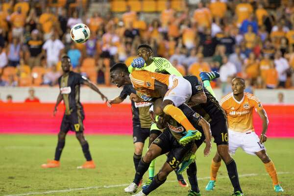 Houston Dynamo defender Jalil Anibaba (2) gets tangled with Philadelphia Union defender Fabinho (33) during the second half of action between the between the Houston Dynamo and the Philadelphia Union during an MLS soccer game at BBVA Compass, Saturday, July 02, 2016, in Houston. Houston Dynamo defeated Philadelphia Union 1-0. (Juan DeLeon/for the Houston Chronicle )