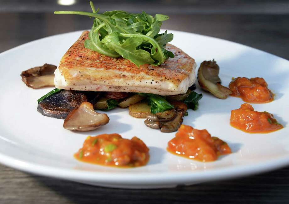 Seared red snapper, a sometime nightly special, at Fish at 30 Lake restaurant Thursday July 21, 2016 in Saratoga Springs, NY.  (John Carl D'Annibale / Times Union) Photo: John Carl D'Annibale / 20037373A