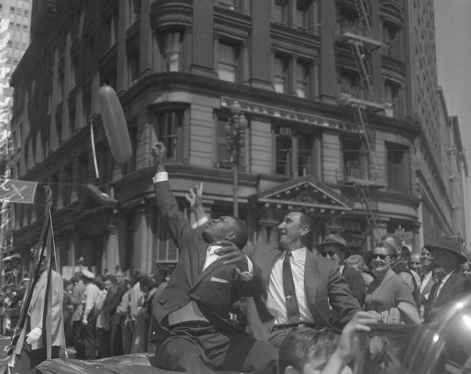 In a parade to welcome the San Francisco Giants in 1958, Willie Mays and Hank Sauer ride in a car. Photo: Arthur Frisch, The Chronicle