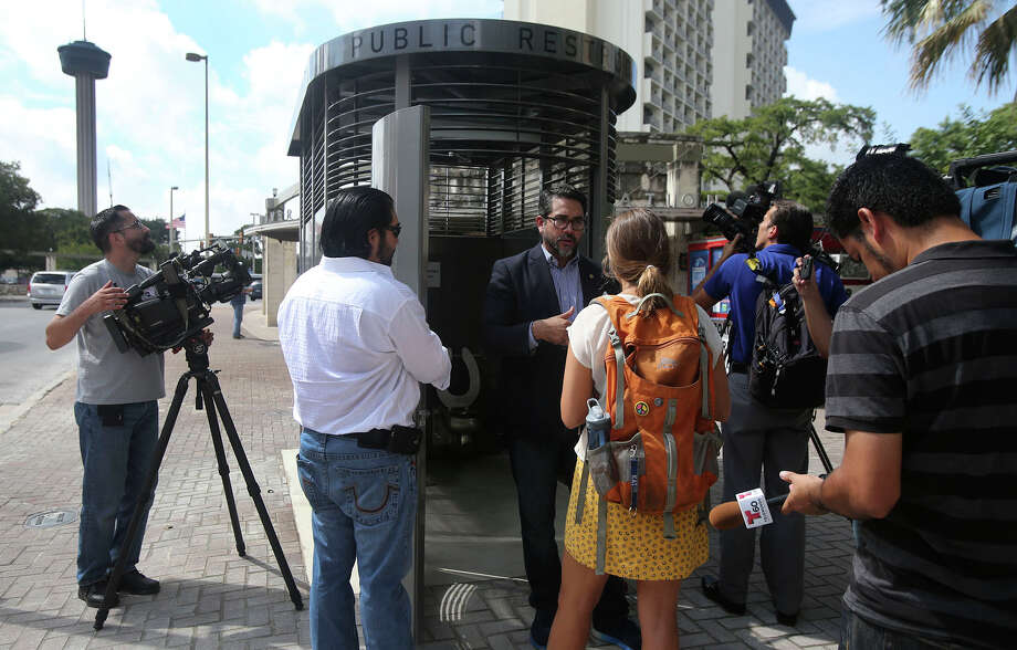 """District 1 city councilman Roberto Trevino (with beard, wearing glasses) speaks Thursday July 28, 2016 about the new public restroom that was installed at Alamo and Commerce in the heart of downtown San Antonio. Trevino said the restroom cost $97,000 and was manufactured by Madden Fabrication in Portlan, Oregon. Trevino said the city plans to identify more sites for the restrooms and said """"this is a great addition to this intersection."""" Photo: John Davenport, San Antonio Express-News / ©San Antonio Express-News/John Davenport"""