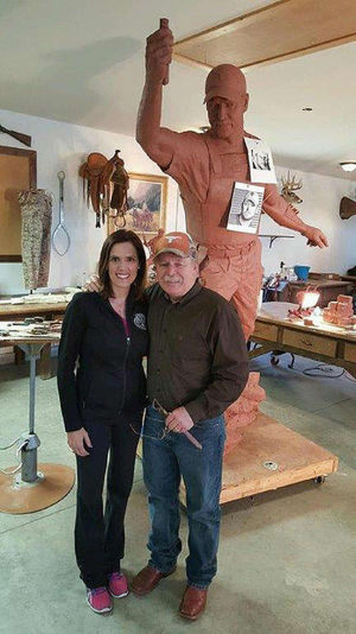Taya Kyle poses with a statue of her late husband Chris Kyle who was portrayed in the film