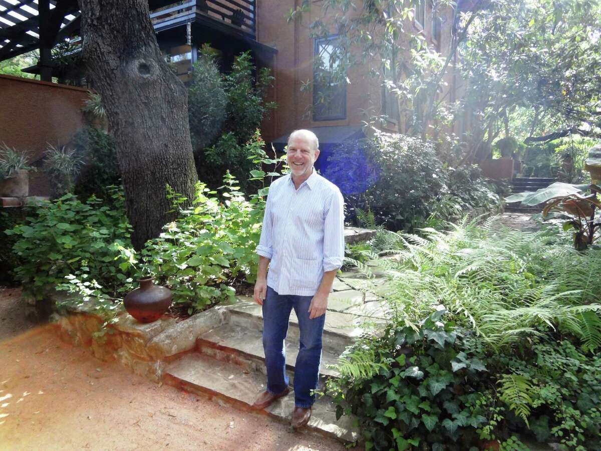 Ted Flato of Lake | Flato Architects stands in the garden outside his 1909 Alamo Heights home, designed by San Antonio architect Harvey Page, whose other buildings include Clara Driscoll's Laguna Gloria in Austin.