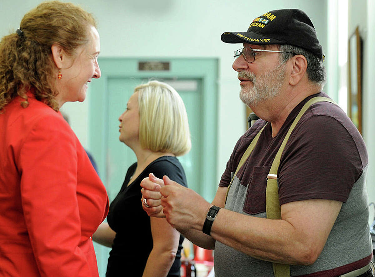 Congresswoman Elizabeth Esty speaks with a constituent on July 22 at the New Milford Senior Center.