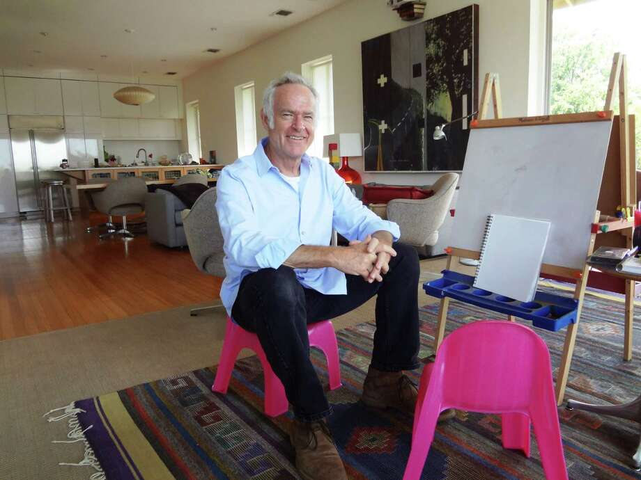 Architect Davis Sprinkle sits at his 3-year-old daughter Olivia's easel at his Monte Vista home. Photo: Steve Bennett /San Antonio Express-News