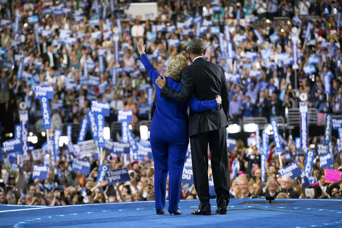 Hillary Clinton, now the party's nominee, and President Barack Obama stand together on stage on the third night of the Democratic National Convention, at the Wells Fargo Center in Philadelphia, July 27, 2016. Both Obama and Vice President Joe Biden spoke to the convention on its third night. (Doug Mills/The New York Times)