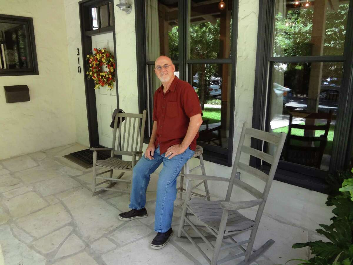 Architect Mickey Conrad, standing on his front porch, is a founder of San Antonio's OCO Architects, which merged with LPA in 2014.