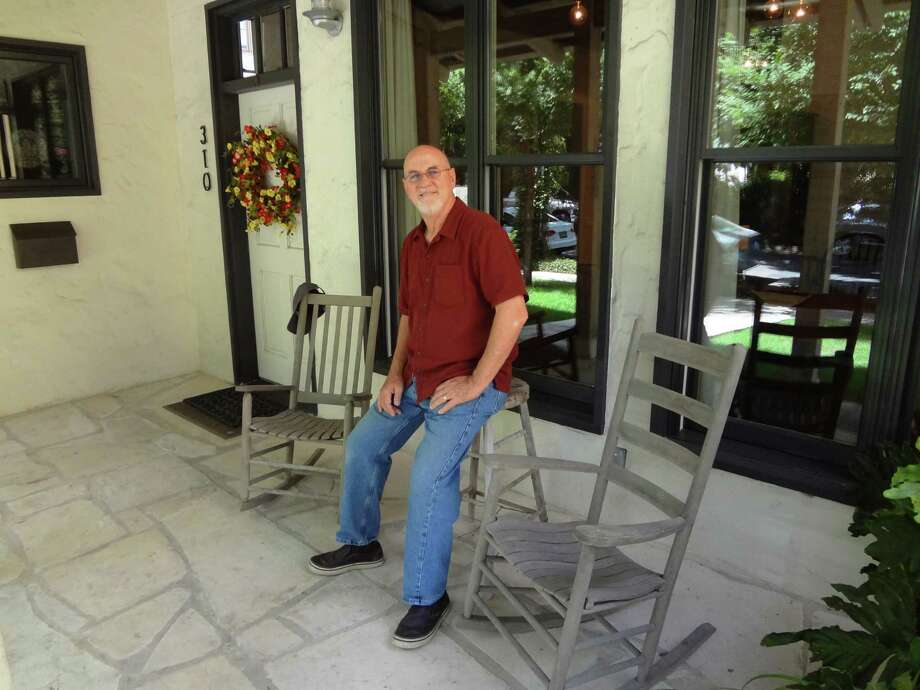 Architect Mickey Conrad, standing on his front porch, is a founder of San Antonio's OCO Architects, which merged with LPA in 2014. Photo: Steve Bennett /San Antonio Express-News