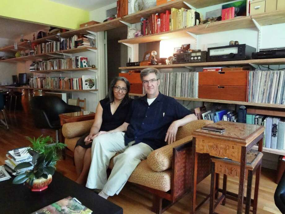 Claudia Guerra, a cultural historian with the Office of Historic Preservation, and David Bogle, owner of Syncro Architecture Studio, live in an Alta Vista duplex. Photo: Steve Bennett /San Antonio Express-News