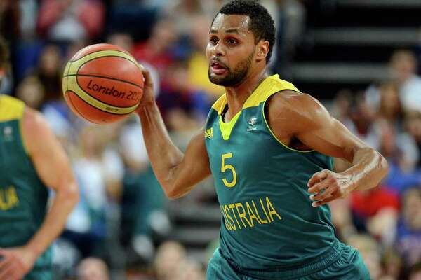 Patty Mills of Australia passes the ball against the United States during the men's basketball quarterfinal game on Day 12 of the London 2012 Olympic Games at North Greenwich Arena on Aug. 8.