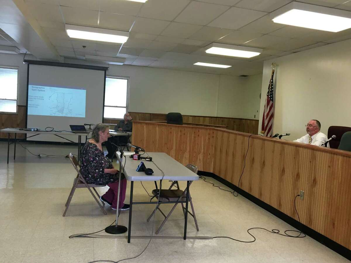 Nancy Benedict, a retired state employee from Delmar, speaks at a Colonie public comment hearing on July 28 about the 518 area code.