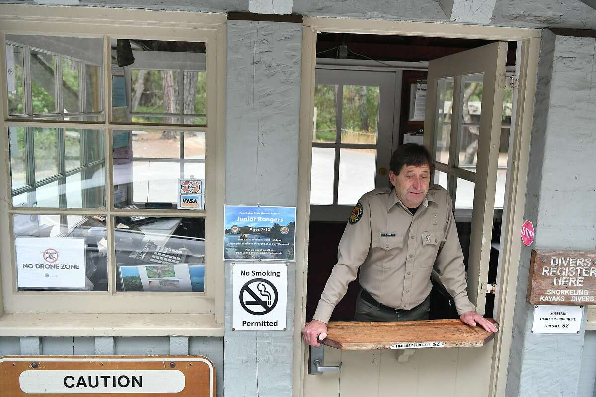 Ken Little monitors a closed entrance to Point Lobos State Reserve park near Carmel California on July 28, 2016. Scorching more than 27,000 acres, the Soberanes Fire has taken a toll on local businesses and caused multiple closures at state parks.