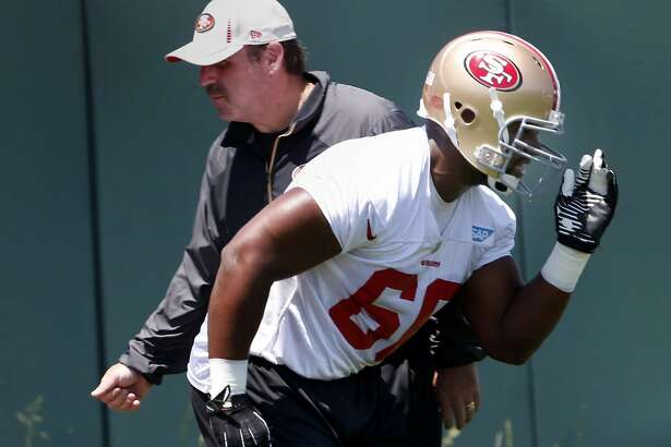 Kaleb Ramsey (60) ran a drill past his coach Tuesday June 3, 2014. The San Francisco 49ers held a spring practice at their facility in Santa Clara, Calif. near the new Levi stadium.