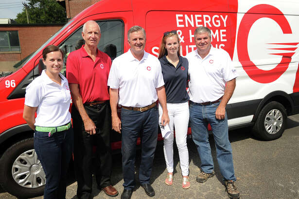 Three generations of the Gault family unveil the company's new name and logo outside the business at 11 Ferry Lane West in Westport, Conn. on Thursday, July 28, 2016. From left are Sales Coordinator Megan Donaher, Bill Gault, President Sam Gault, Marketing Director Meredith Donaher, and Vice President Jim Donaher.