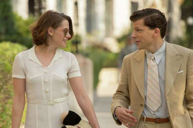 """In this image released by Lionsgate, Jesse Eisenberg, right, and Kristen Stewart appear in a scene from """"Cafe Society."""" (Sabrina Lantos/Lionsgate via AP) ORG XMIT: NYET113"""