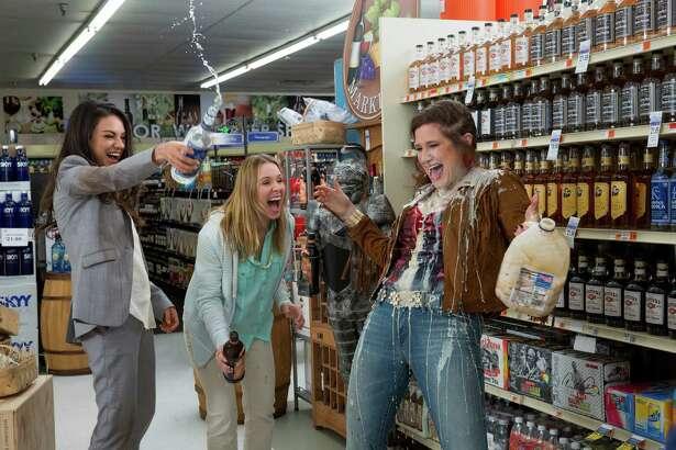 "Mila Kunis, from left, Kristen Bell and Kathryn Hahn let loose in ""Bad Moms."""