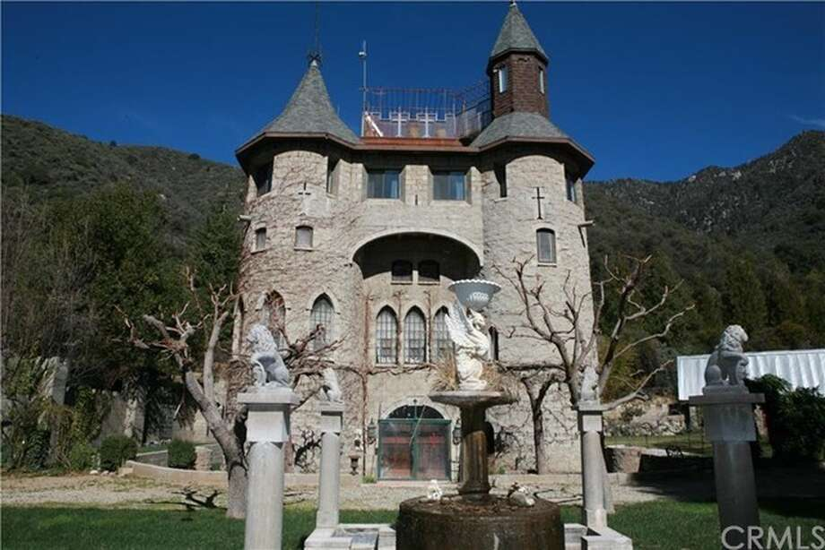 Originally listed at $4.9 million, this castle made from cut-stone amid the trees at the foot of the San Bernardino Mountains is now on the market for $849,000. Photo: Best Properties