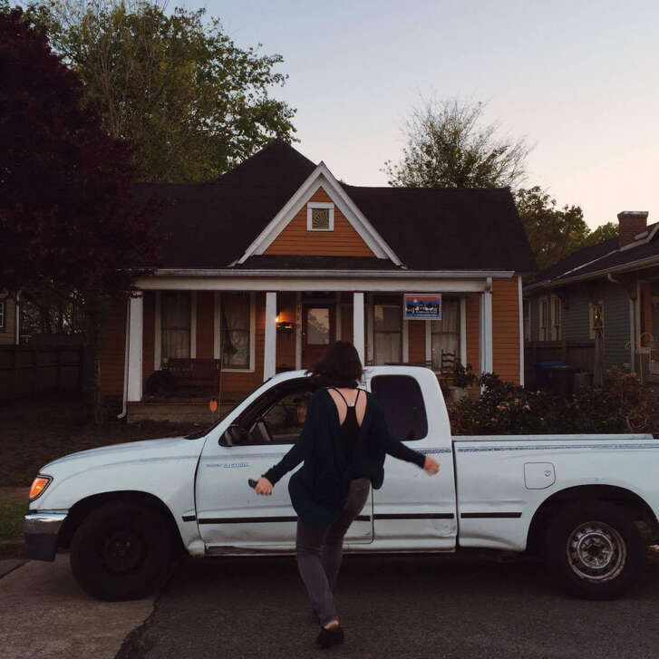 The author in front of the house she purchased when she decided to stop searching for someone and put down roots of her own. MUST CREDIT: Kjersti Brocker.