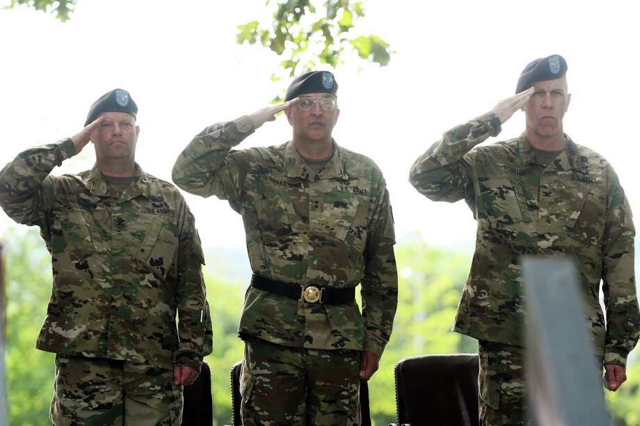 Incoming arsenal commander, Colonel Joseph Morrow, left, Major General Clark LeMasters Jr., center, commander of the U.S. ArmyTACOM Life Cycle Management Command, and outgoing arsenal commander Colonel Lee Schiller Jr., right, salute during a change of command ceremony at the Watervliet Arsenal on Thursday, July 28, 2016, in Watervliet, N.Y.    (Paul Buckowski / Times Union) Photo: PAUL BUCKOWSKI / 20037450A