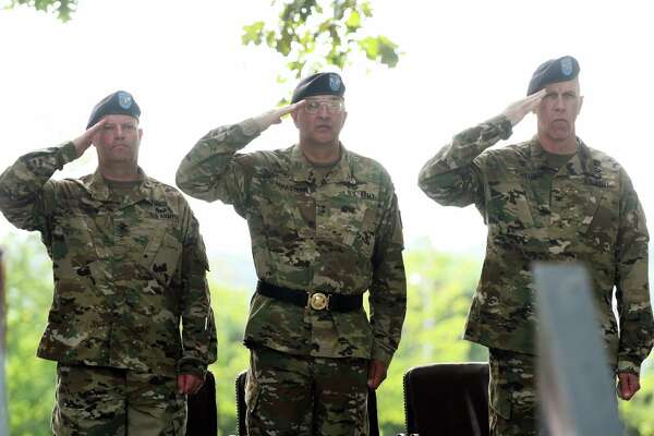 Incoming arsenal commander, Colonel Joseph Morrow, left, Major General Clark LeMasters Jr., center, commander of the U.S. ArmyTACOM Life Cycle Management Command, and outgoing arsenal commander Colonel Lee Schiller Jr., right, salute during a change of command ceremony at the Watervliet Arsenal on Thursday, July 28, 2016, in Watervliet, N.Y.    (Paul Buckowski / Times Union)