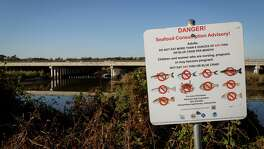 A sign warns fisherman and visitors not to eat contaminated seafood caught from the water along I-10 near the San Jacinto River east of Houston, Tuesday, Dec. 17, 2013, in Channelview. EPA's affinity for designating river megasites for federal Superfund action is growing, with combined hazardous and biological remedies under way on the East and West Coasts and in the Midwest. Is our San Jacinto River next on the list?  ( Michael Paulsen / Houston Chronicle )