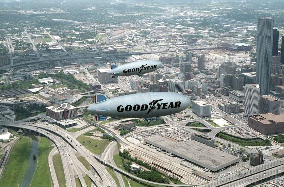 The Goodyear blimp Columbia takes a tour of Houston with its replacement, also named Columbia, July 1, 1986. Photo: E. Joseph Deering, Houston Chronicle