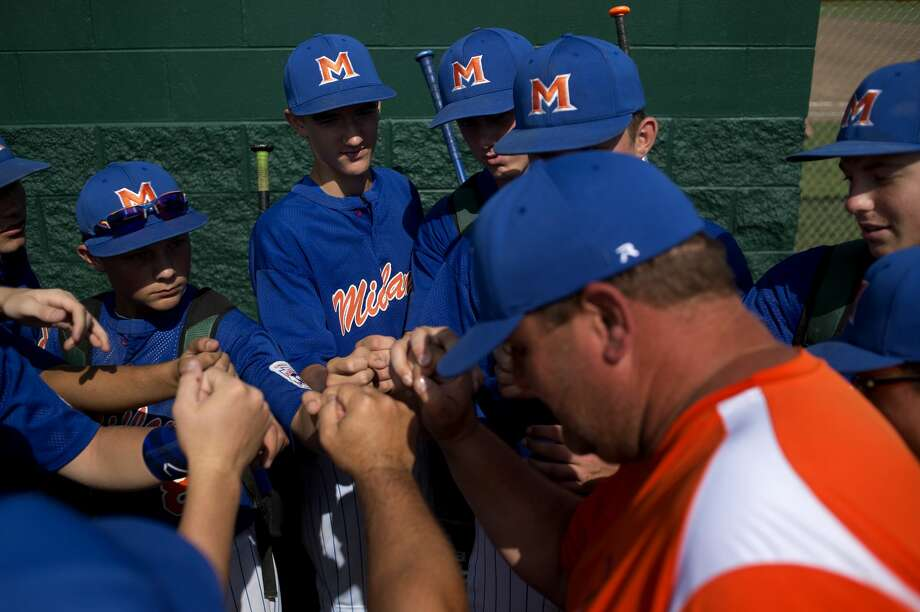 "Midland Junior All-Star's head coach Ched Johnson congratulates his team on defeating North Saginaw, 12-2,  in Larkin Township on Thursday. ""They are a good team and you should look at the scoreboard because you did that,"" Johnson said. ""Good work boys."" Photo: Brittney Lohmiller/Midland Daily News/Brittney Lohmiller, Brittney Lohmiller/Midland Daily News"