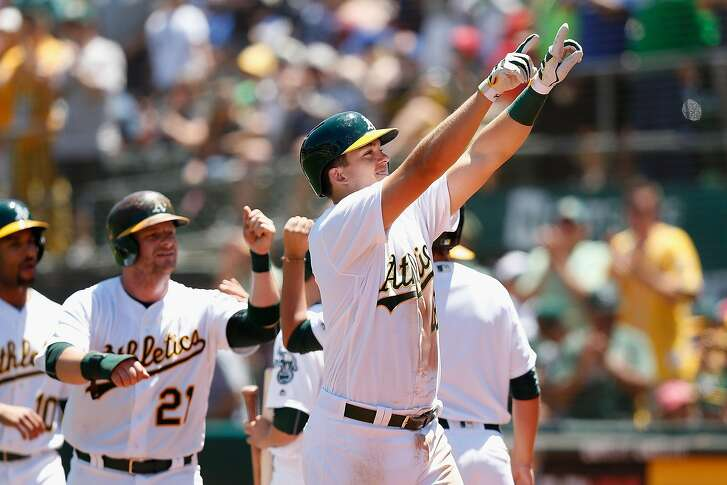 OAKLAND, CA - JULY 16: Ryon Healy #48 of the Oakland Athletics celebrates after hitting a home run in the second inning against the Toronto Blue Jays at O.co Coliseum on July 16, 2016 in Oakland, California. (Photo by Lachlan Cunningham/Getty Images)