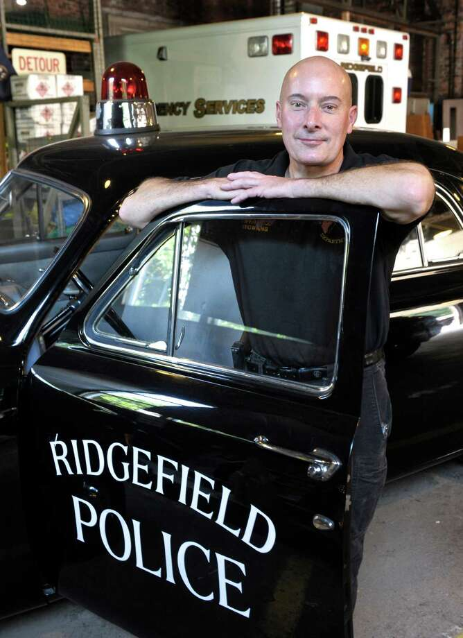 Bill Browning, a Ridgefield Police Department Communications Supervisor, has restored a 1951 Ford to match the original car the department had. The cruiser is owned by the Ridgefield Police Union and is used for fund raising and other events. Thursday, July 28, 2016, in Ridgefield, Conn. Photo: H John Voorhees III, Hearst Connecticut Media / The News-Times