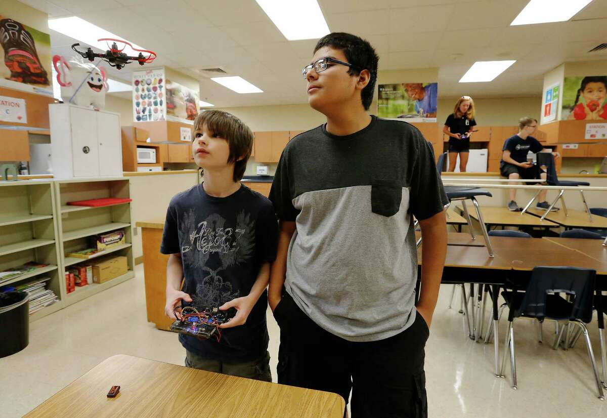 Incoming Roosevelt High School freshmen Connor Mellor (left) and Brandon Ochoa keep an eye on their drone as 25 NEISD middle and high school students attend Drone Camp where students build and program their own drones. On Thursday, July 28, 2016, the last day of camp, students flew their drones through a makeshift obstacle course at Roosevelt High School. The students consisted of middle and high school NEISD students. Many attend Ed White Middle School and Roosevelt High School's magnet programs: Design and Technology Academy (DATA) and Engineering and Technology Academy (ETA). Sponsor CoDrone just got off Kickstarter and the district was one of the first in the country to host a camp according to the official press release. (Kin Man Hui/San Antonio Express-News)