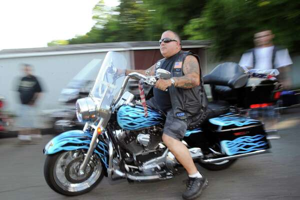 Rocco Ceci, president of the Cos Cob Riders motorcycle club, rides his 2004 Harley-Davidson Road King motorcycle during the club's weekly get together at Joey B's Famous Chili Hub in Cos Cob.