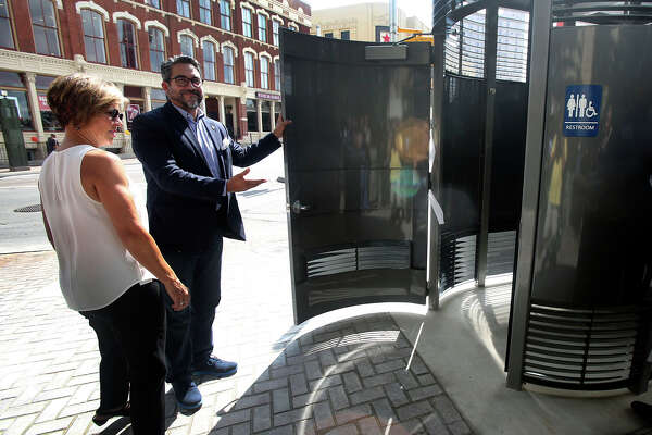 1of9district 1 Councilman Roberto Treviño With City Manager Sheryl Sculley Introduces The New Public Restroom That Was Installed In Heart Of Downtown