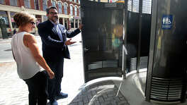 "District 1 Councilman Roberto Treviño, with City Manager Sheryl Sculley, introduces the new public restroom that was installed in the heart of downtown. The Porland Loo ""is a great addition to this intersection,"" Treviño said."